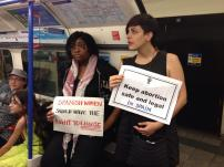 A member of the Women's Assembly and rs21 protesting in the London tube against the Spanish antiabortion bill.